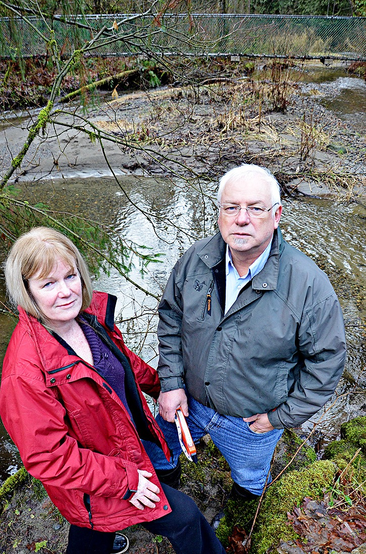 Annabel Young and Dr. Marvin Rosenau at West Creek just steps from the existing pipeline.